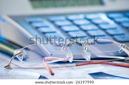 accounting concept with calculator glasses figures  for business balance