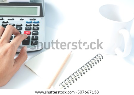 Accounting concept with woman's hand, empty notebook with copy space, color filter