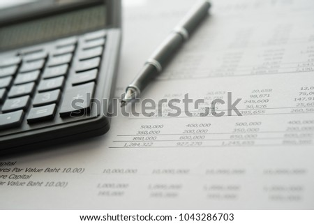 Accounting financial business concept. closeup calculator on financial statement.