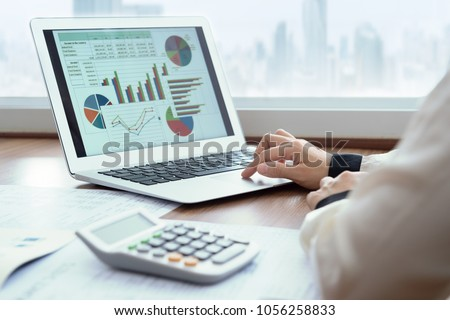 Accounting report spreadsheet. Business women using computer prepare business report for evaluation performance.