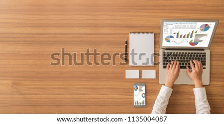 Accounting report spreadsheet. Business women using computer prepare business report for evaluation performance. above view and wide copy space.