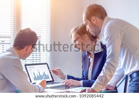 Accounting team discussing financial report data with chart on computer screen in office, consulting people reviewing corporate strategy and business analytics metrics