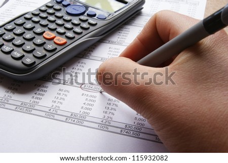 Accounts and charts with business equipment