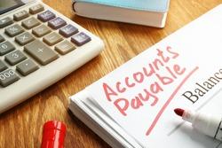 Accounts payable handwritten by marker on balance sheet.