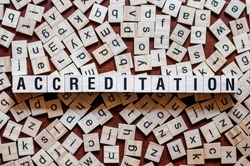 Accreditation word concept on cubes for articles