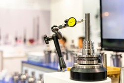 Accuracy and precision indicator dial gauge setting on stand equipment and during measuring dimension roundness etc of metal shaft product