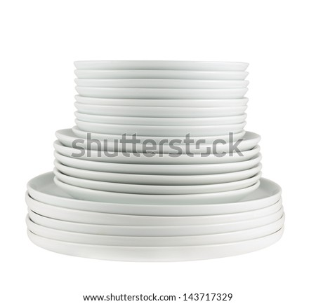 Accurate pile stack of the round ceramic white dish plates isolated over white background