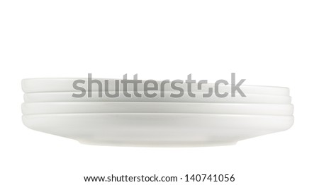 Accurate pile stack of the round ceramic white dish plates isolated over white background, side view
