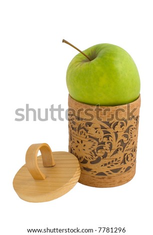Accurate wooden gift box with a green apple isolated on white