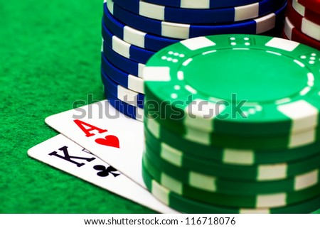 Ace, king and poker chips stack