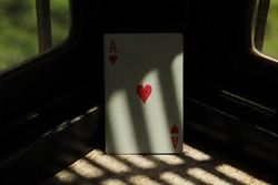 Ace of hearts poker playing card with light and shadow pattern