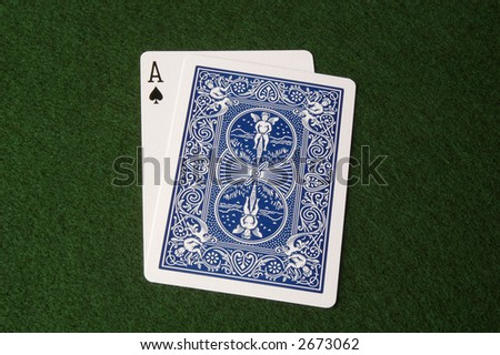 Ace showing, cards covering; might be blackjack