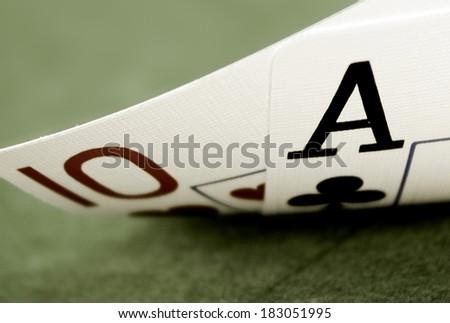 ace ten  on green felf Macro shot Stock fotó ©