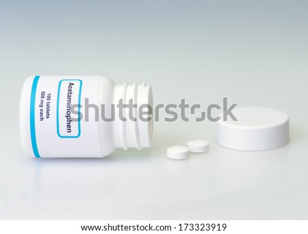 Acetaminophen bottle and pills on light blue background.  Label is not real.