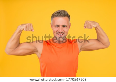 Achieve best shapes. Sportsman physically fit. Active sportsman. Healthy lifestyle. Sport and fitness. Muscular body. Training and workout. Mature and attractive. Strong sportsman in gym clothes.