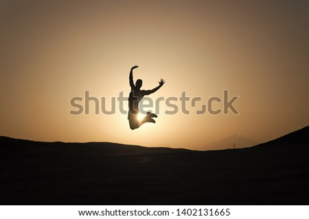 Achieve main goal. Silhouette man motion jump in front of sunset sky background. Future success depends on your efforts now. Daily motivation. Healthy lifestyle personal achievement goal and success.