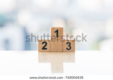 Achievement concept. Wooden podium standing on white background #768006838