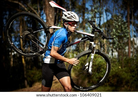 Achievement / Effort concept: Successful young man running a race with a bike