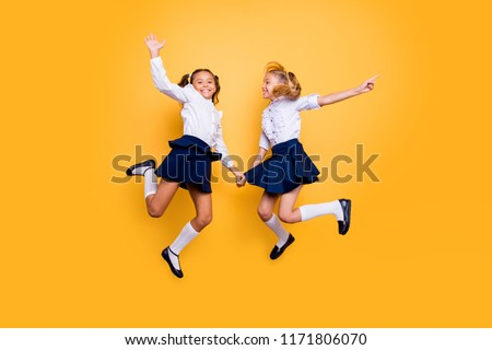 Achievements concept, dynamic images. Full length, legs, body, size portrait of nice, lovely, sweet, beautiful, careless, small girls in formal wear jumping isolated on yellow background #1171806070