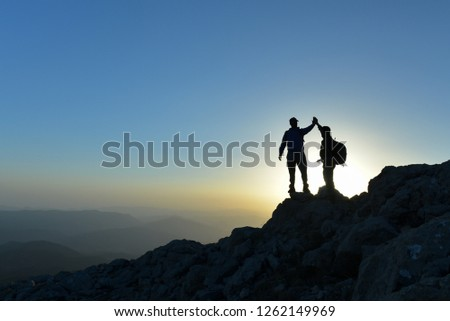 achieving and achieving specific goals in the mountains #1262149969