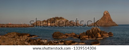 Aci Trezza is a town in Sicily.Of the coast are three tall, column-shaped islands. Local legend, these great stones are the ones thrown at Odysseus in The Odyssey :the islands of the Cyclops #1339514306