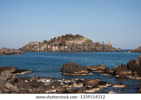 Aci Trezza is a town in Sicily.Of the coast are three tall, column-shaped islands. Local legend, these great stones are the ones thrown at Odysseus in The Odyssey :the islands of the Cyclops #1339514312