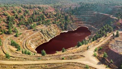 Acidic red lake in open pit of abandoned Kokkinopezoula copper mine in Mitsero, Cyprus