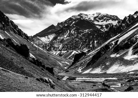 Aconcagua Peak. Aconcagua is the highest mountain in America and the Western and Southern Hemispheres at 6,960.8 metres. It is located in the Andes mountain range, in Mendoza, Argentina. #312944417