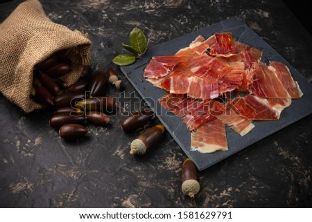 Acorn ham concept. pork product fed with oak acorns, also known in spain as black legged ham