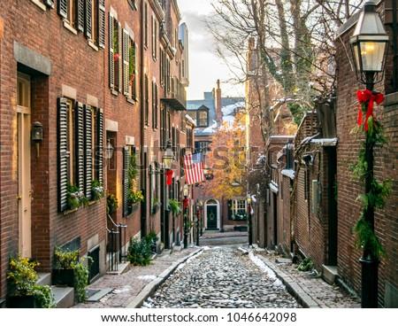 "Acorn Street at Christmas Time: Classic ""All-American"" New England Cobblestone Street, Brick Buildings, and American Flag in Historic Beacon Hill Neighborhood (Winter) - Boston, Massachusetts, USA  #1046642098"