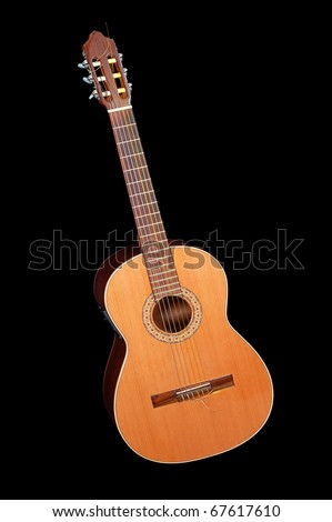 Acoustic classic guitar on a black background - stock photo