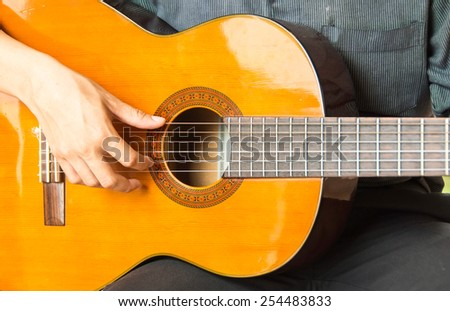 Acoustic guitar guitarist playing.Close up of guitarist hand playing acoustic guitar