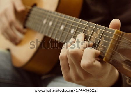 Acoustic Guitar Guitarist Playing. Musical Instrument With Performer Hands
