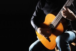 Acoustic guitar hands closeup playing classical guitar player music instrument