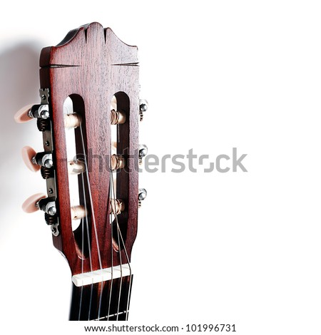 Acoustic guitar head neck on white background - stock photo