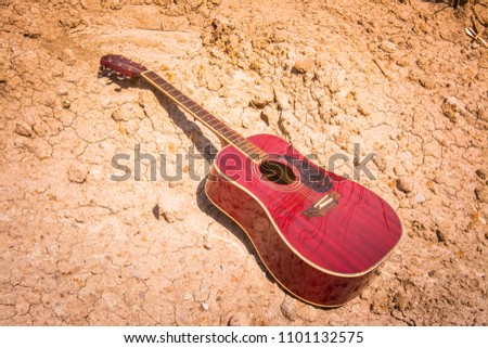 acoustic guitar lying on a...