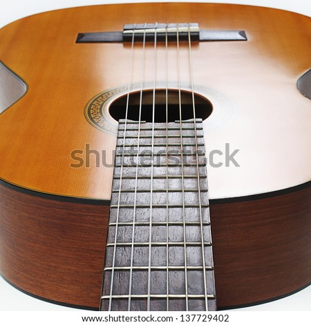 Acoustic guitar musical instrument string details close-up