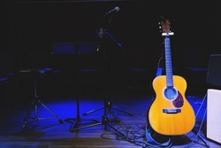 Acoustic guitar. Musical instrument with on stage in Concert.