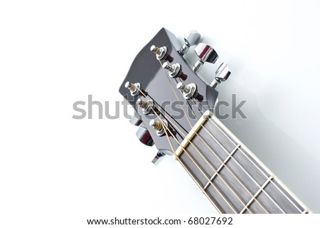 Acoustic guitar neck close-up on a white background.