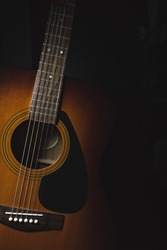 Acoustic guitar on a dark background