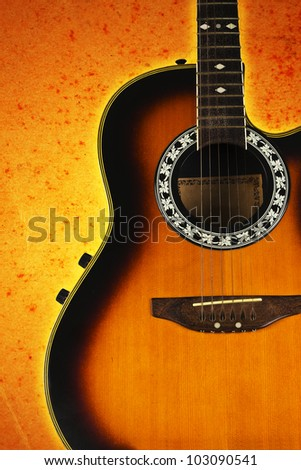 acoustic guitar on an abstract background.