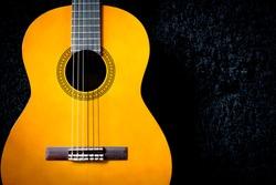 acoustic guitar on black carpet
