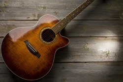 Acoustic guitar on wood background