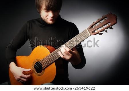 Acoustic guitar player guitarist man classical guitar playing
