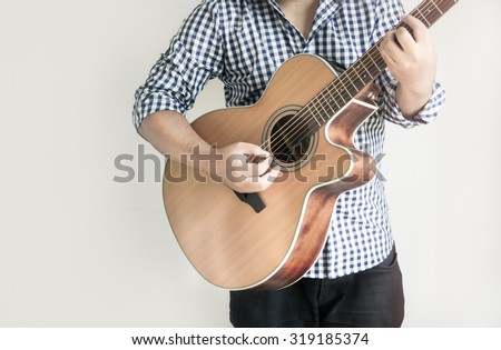 Acoustic Guitar Playing. Men Playing Acoustic Guitar