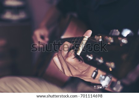 Acoustic Guitar Playing. Men Playing Acoustic Guitar,Closeup Photo,Vintage filter #701114698