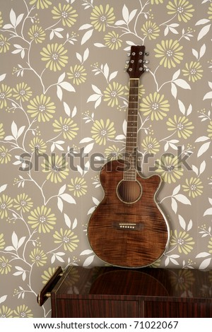 acoustic guitar retro on vintage 60s wallpaper wooden furniture