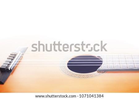 Acoustic guitar strings. Classical guitar closeup. Spanish music instrument close up