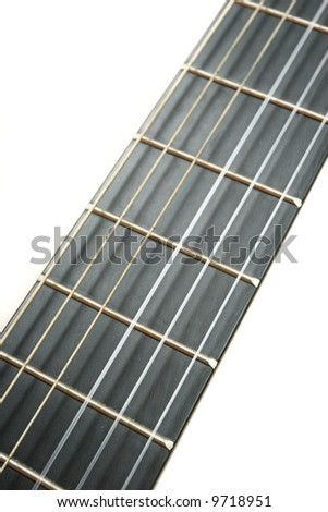 Acoustic guitar strings close up on white background