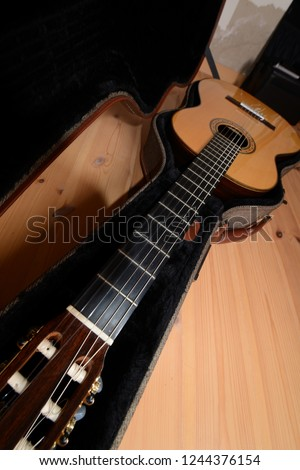 acoustic guitar, view from the 50s headstock - Shutterstock ID 1244376154
